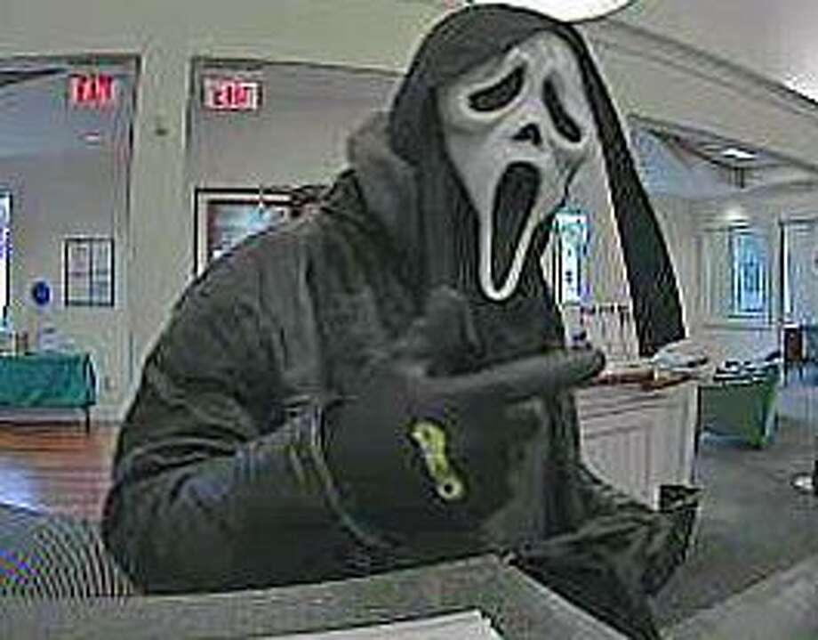 "Norwalk police are looking for this man who held up the First County Bank on Main Avenue on Tuesday, Dec. 6, 2016. Lt. Terry Blake says the man, believed to be a white Caucasian, wore a 'ghost Halloween"" mask. Photo: Norwalk Police Department"