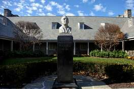 """FILE - This Monday, Nov. 2, 2009, file photo shows the bust of President Franklin D. Roosevelt in front of the Franklin D. Roosevelt Presidential Library and Museum in Hyde Park, N.Y. The library and museum is marking its 75th anniversary, being celebrated Thursday, June 30, 2016, with a ceremony for library members and invited guests only, followed by the public opening of the library exhibit """"Day of Infamy: 24 Hours that Changed History."""" (AP Photo/Craig Ruttle, File)"""