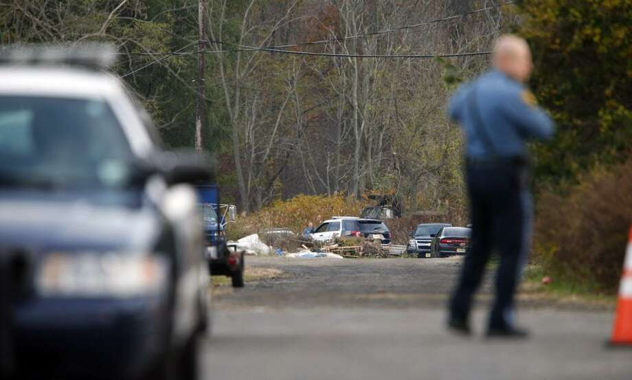 FILE — Oceanport police control access on the long driveway that leads to the rear of Foggia Florist in Oceanport, N.J., Wednesday, Nov. 16, 2016. Police believe a body discovered in the New Jersey city is that of a Connecticut man who went missing after attending a party at a luxury apartment building in New York City over the weekend. Joseph Comunale, of Stamford, Conn., was last seen entering the Grand Sutton building in Manhattan on Sunday morning. (Thomas P. Costello/The Asbury Park Press via AP) Photo: Thomas P. Costello / Associated Press / Gannett NJ / USA Today Network