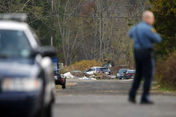 FILE — Oceanport police control access on the long driveway that leads to the rear of Foggia Florist in Oceanport, N.J., Wednesday, Nov. 16, 2016. Police believe a body discovered in the New Jersey city is that of a Connecticut man who went missing after attending a party at a luxury apartment building in New York City over the weekend. Joseph Comunale, of Stamford, Conn., was last seen entering the Grand Sutton building in Manhattan on Sunday morning. (Thomas P. Costello/The Asbury Park Press via AP)