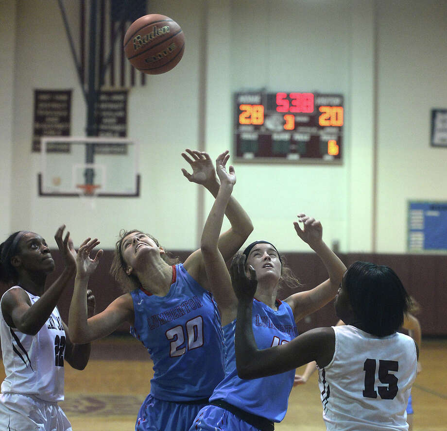 Central's Anastacia Mickens (left) and Dereca Garrett close in as Lumberton's Erin Talley (left) and Brittany Yarbro look to secure the rebound during Tuesday night's district opening match-up at Central High School.  Photo taken Tuesday, December 6, 2016 Kim Brent/The Enterprise Photo: Kim Brent / Beaumont Enterprise