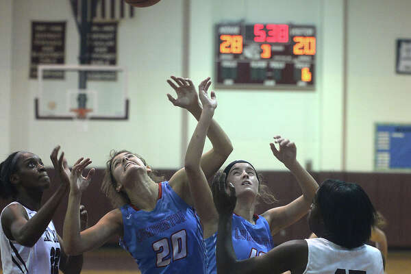 Central's Anastacia Mickens (left) and Dereca Garrett close in as Lumberton's Erin Talley (left) and Brittany Yarbro look to secure the rebound during Tuesday night's district opening match-up at Central High School.  Photo taken Tuesday, December 6, 2016 Kim Brent/The Enterprise