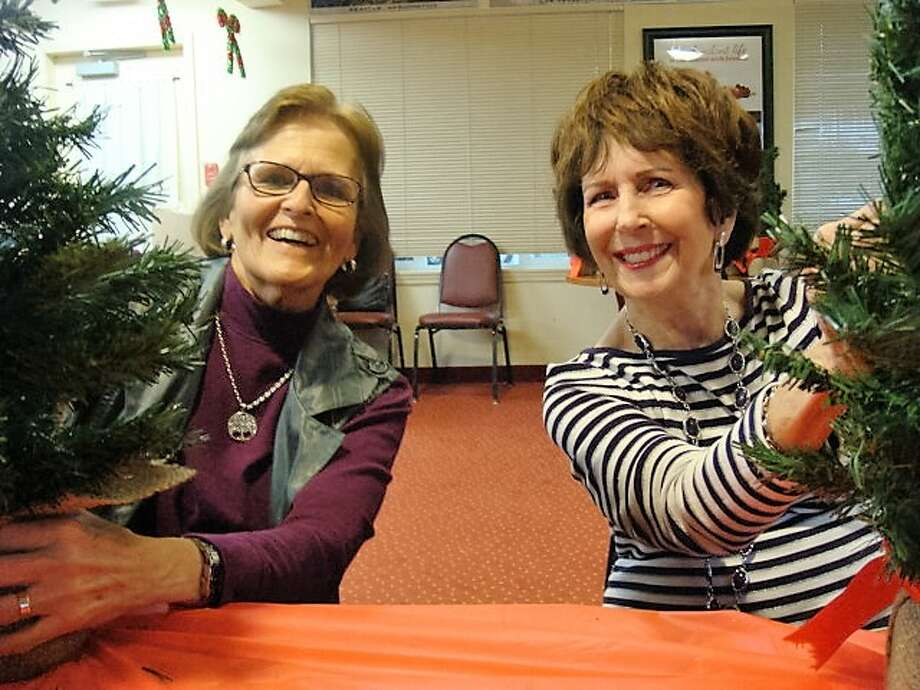 Barbara Hemphill and Halene Crossman volunteered to decorate the trees. Photo: Submitted