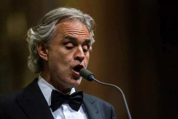 Italian tenor Andrea Bocelli performs during a concert in St. Stephen's Basilica in Budapest, Hungary, Saturday, Nov. 5, 2016. (Zsolt Szigetvary/MTI via AP)