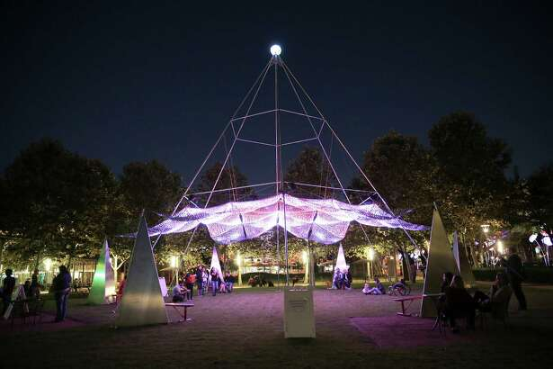 """The LED light display """"Firmament,"""" by artist Christopher Schardt, hangs from a giant frame set up at Discovery Green."""