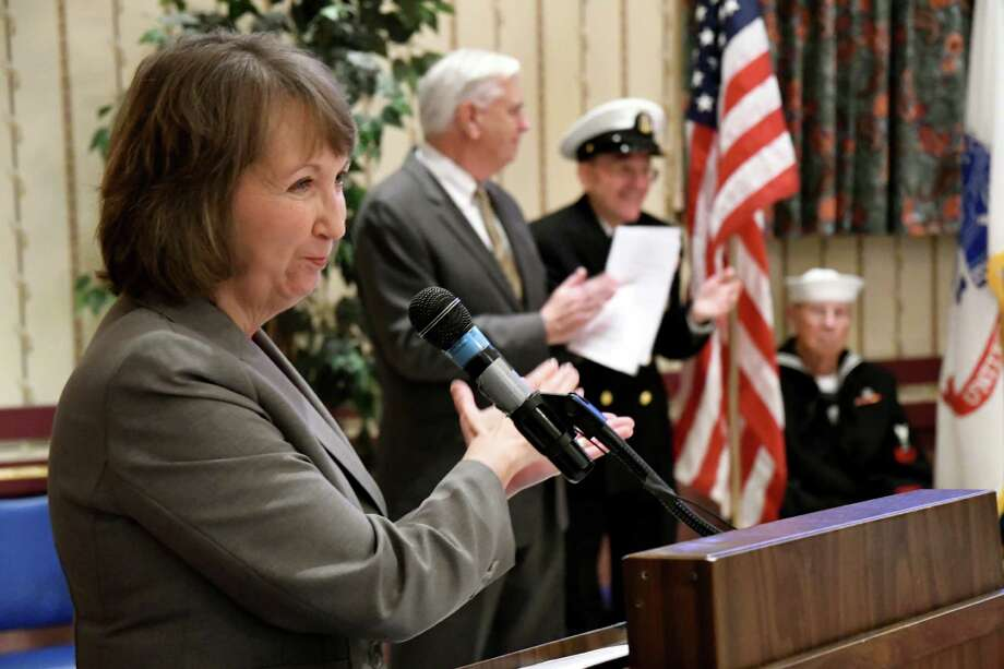 Rensselaer County Executive Kathy Jimino, left, applauds veterans during the Pearl Harbor Remembrance Ceremony on Wednesday, Dec. 7, 2016, at Joseph E. Zaloga Post No. 1520 in Albany, N.Y. (Cindy Schultz / Times Union) Photo: Cindy Schultz / Albany Times Union