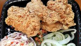 Fried chicken, cole slaw and pickled onions from the Bill Miller Bar-B-Q restaurant on Bill Miller Lane.