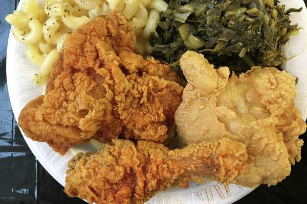 Spicy and regular fried chicken, mac and cheese and greens from Chatman's Chicken on South W.W. White Road.