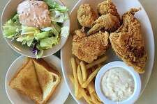 A four-piece fried chicken dinner with fries, salad, gravy and Texas toast from Mary Ann's Pig Stand on Broadway.