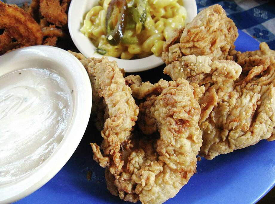 Click ahead to view 19 places for fried chicken in San Antonio.1. Two-piece fried chicken lunch with sides of mac and cheese and onion rings from Radicke's Bluebonnet Grill. Photo: Mike Sutter /San Antonio Express-News