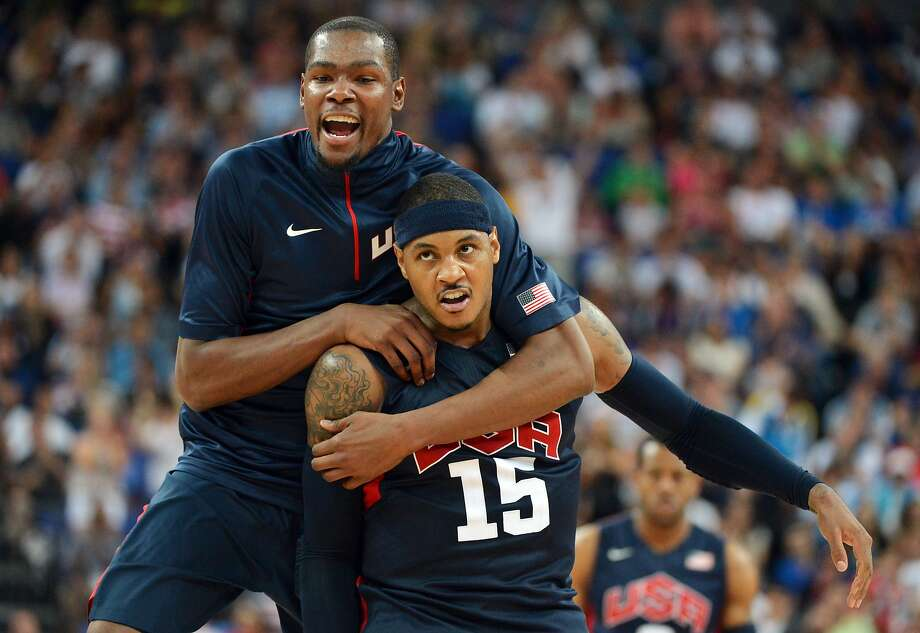 US forward Carmelo Anthony (R) celebrates with US forward Kevin Durant after winning 109-83 against Argentina during the London 2012 Olympic Games men's semifinal basketball game between Argentina and the USA at the North Greenwich Arena in London on August 10, 2012. AFP PHOTO /MARK RALSTONMARK RALSTON/AFP/GettyImages Photo: MARK RALSTON, AFP/Getty Images