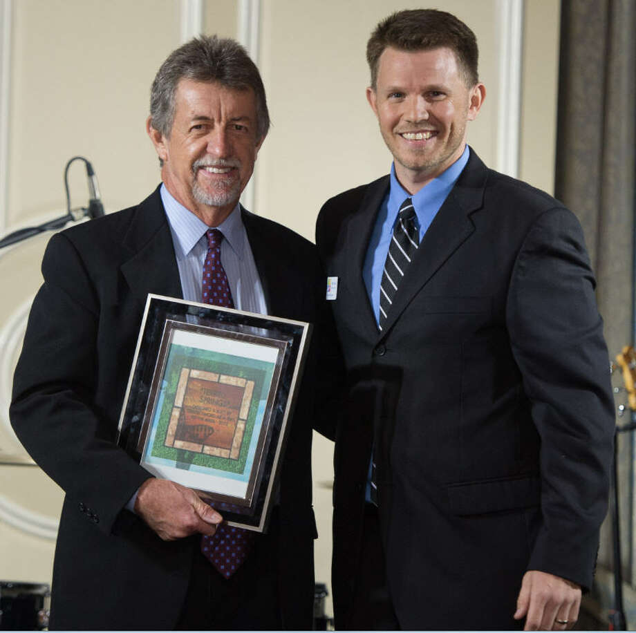 Terrell Sword, owner of Sword Plumbing, was presented with the President's Award for his efforts in park maintenance. With him is Henry Owen, executive director of the Nature Discovery Center. Photo: Nature Discovery Center