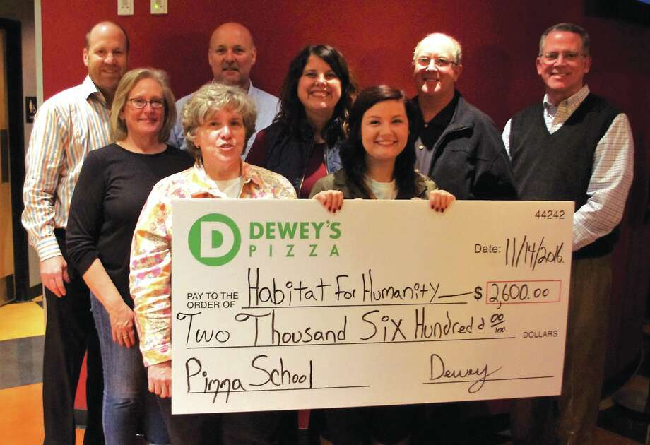 Edwardsville/Glen Carbon Habitat for Humanity Chapter board members recently accepted a donation check from Kaitlyn Taylor, Edwardsville DewMore representative, for $2,600.  The donation was the result of a fundraising pizza school held at the Edwardsville Dewey's location, where employees donated their time to help patrons make their own pizzas.  The staff also donated all drink proceeds and tips to Habitat for the day.  For more information, visit edglenhabitat.org. Photo: For The Intelligencer