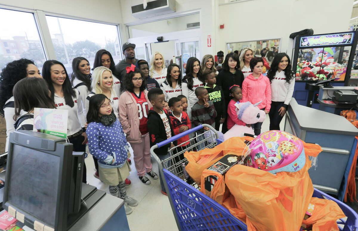 Former Texan Andre Johnson provides a holiday shopping spree for 12 children in Harris County's Dept. of Family Protective Services at Toys R Us on Wednesday, Dec. 7, 2016, in Houston. With the help of the Texan cheerleaders, each child had 80 seconds (in honor of Johnson's jersey number) to grab as much as they can. Johnson's total shopping bill this year was $19144.58.