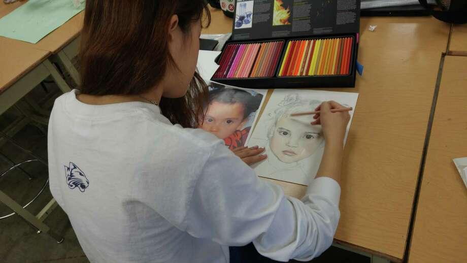 A Westbury Christian School art student works on the Memory Project. Photo: Westbury Christian School