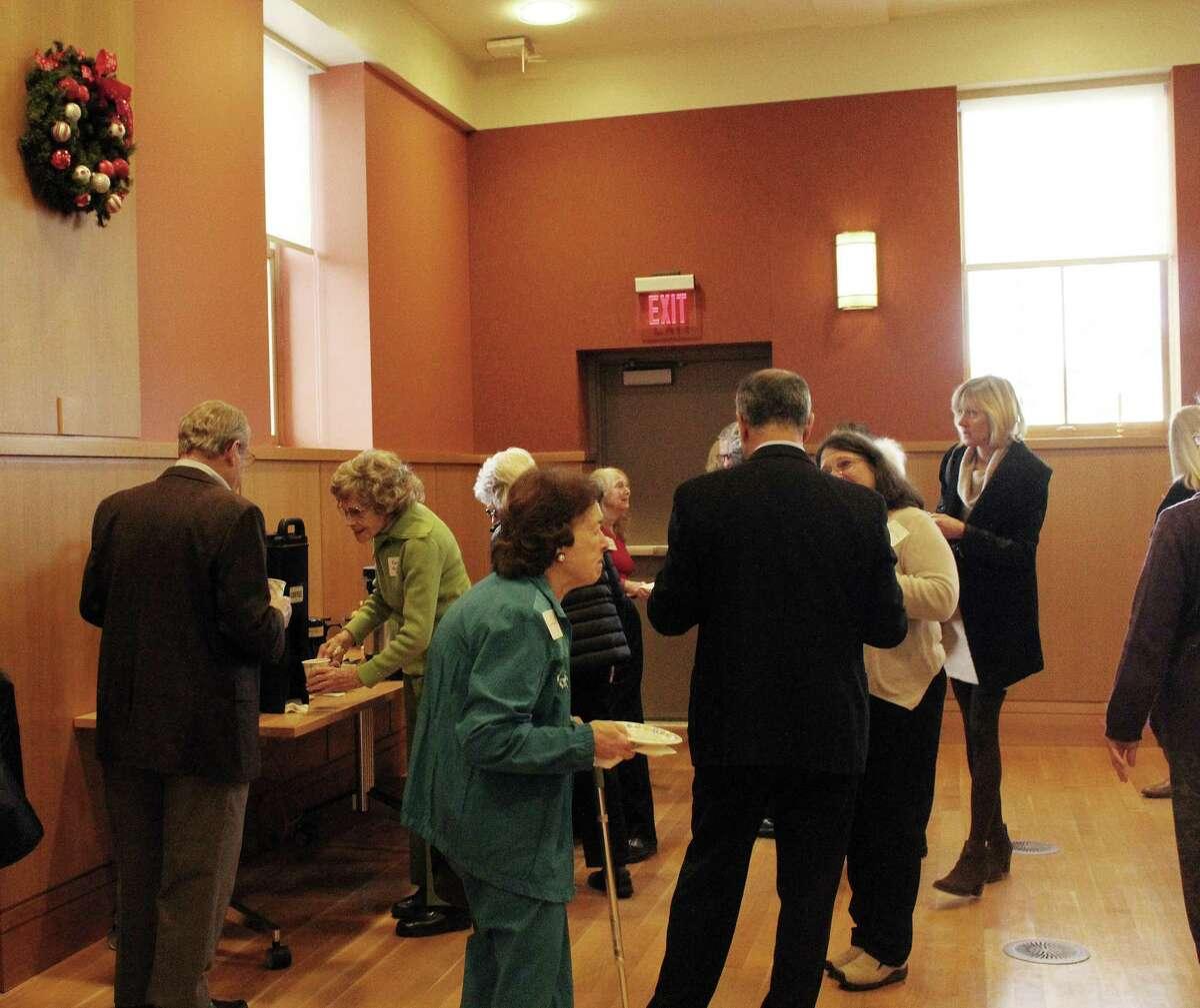 Seniors of Darien mingled before the annual meeting of At Home in Darien at the Darien Library in Darien, CT on Dec. 6, 2016.