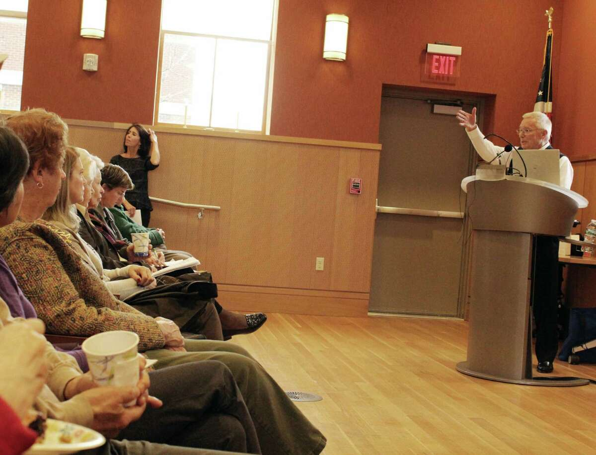 Peter Eder from the Board of Directors of At Home in Darien addresses the crowd at the organization's annual meeting on Dec. 6, 2016 in the Darien Library in Darien, CT.