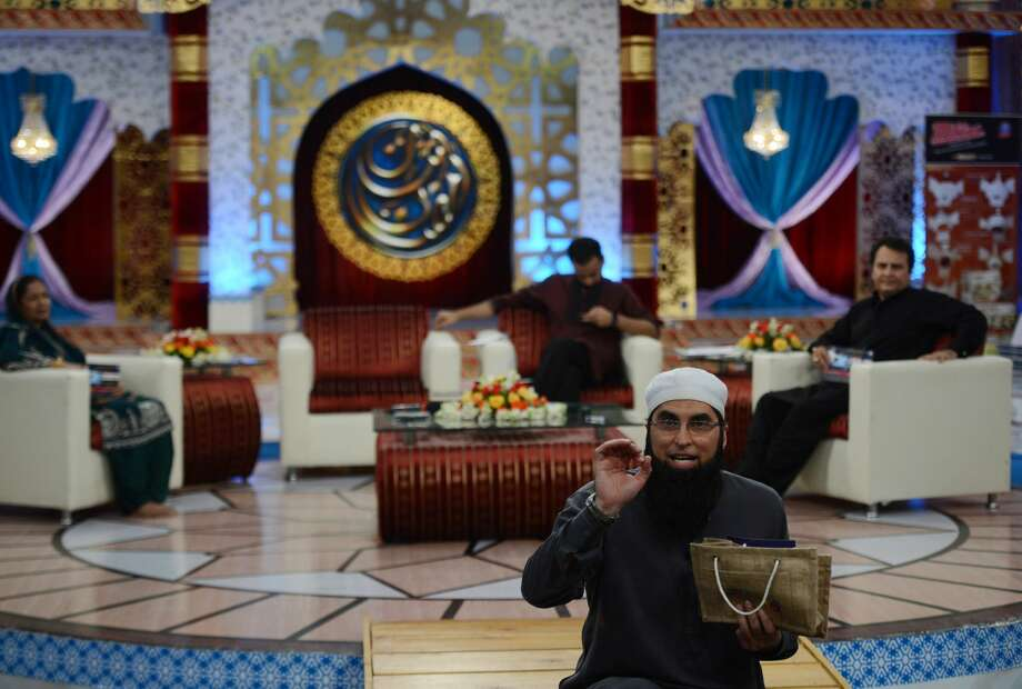 Pakistani pop star dies in plane crashJunaid Jamsheed presents an Islamic quiz show Shan-e-Ramadan in Karachi. Jamshed, a pop star turned televangelist, was killed in a plane crash on Dec. 7, 2016. He owned clothing stores in Houston, Dallas, Chicago and New York. Photo: ASIF HASSAN/AFP/Getty Images
