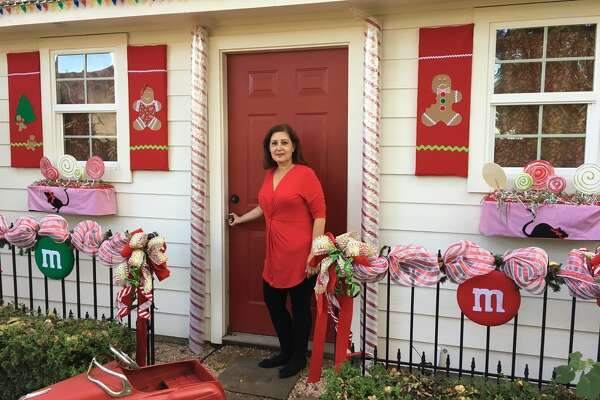 Diana Miller has transformed her storage shed to a gingerbread house.