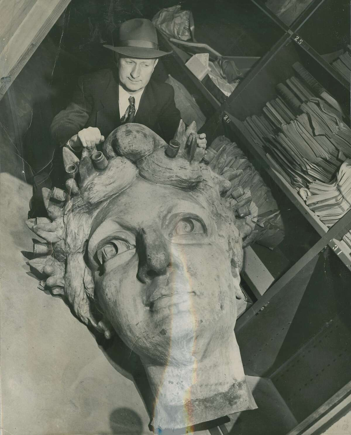 Historic views of old and new San Francisco City Hall. William Irvine with the head of the Goddess of Progress, which stood atop the old San Francisco City Hall, March 28, 1949.