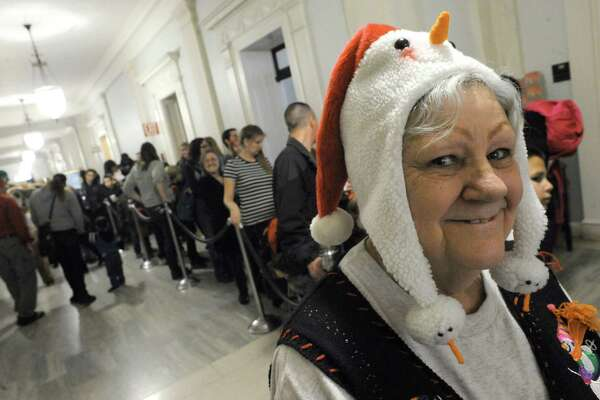 Pat Rejack of Schenectady waits in line to visit Santa during the Downtown Schenectady's City Hall-iday on Saturday Dec. 12, 2015 in Schenectady, N.Y.  (Michael P. Farrell/Times Union)