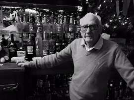 Bob Dougherty presides over the bar at Aunt Charlie's Lounge