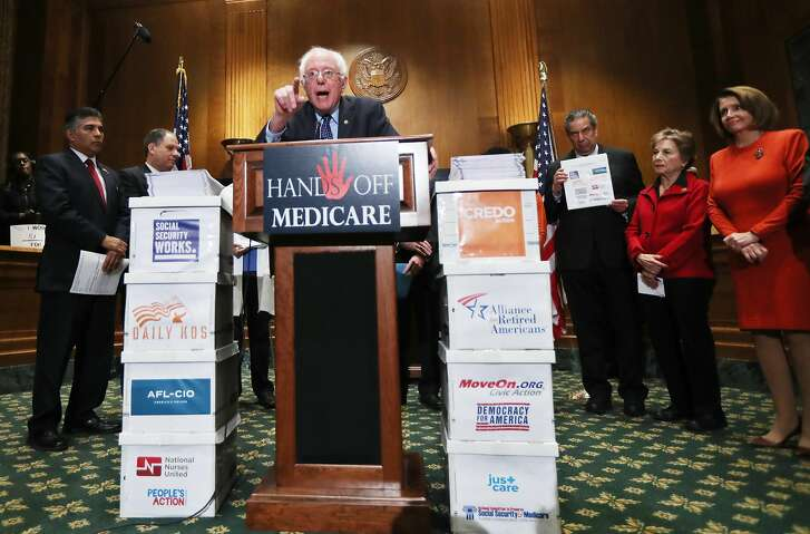 """Sen. Bernie Sanders, I-Vt., with House Minority Leader Nancy Pelosi of Calif., right to left, and Rep. Jan Schakowsky, D-Ill., speaks during a news conference on Capitol Hill in Washington, Wednesday, Dec. 7, 2016, to deliver over million petition signatures demanding that President-elect Donald Trump, House Speaker Paul Ryan, and Senate Majority Leader Mitch McConnell """"keep their hands off the American people's earned Medicare benefits."""" (AP Photo/Manuel Balce Ceneta)"""