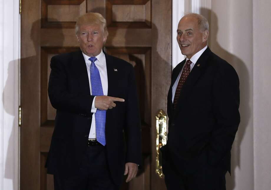 FILE - In this Nov. 20, 2016 file photo, President-elect Donald Trump talks to media as he stands with retired Marine Gen. John Kelly, at the Trump National Golf Club Bedminster clubhouse in Bedminster, N.J. Trump is tapping another four-star military officer for his administration. He has picked Kelly to lead the Homeland Security Department, according to people close to the transition. (AP Photo/Carolyn Kaster, File) Photo: Carolyn Kaster, Associated Press