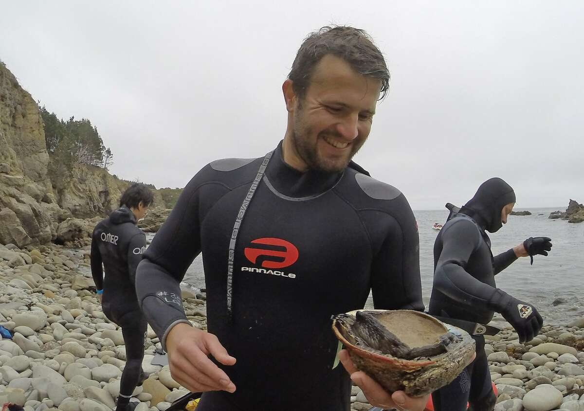 DCIM\116GOPROSebastian Erggelet examines his first abalone at Salt Point State Park in Sonoma County on Saturday, May 2, 2015.