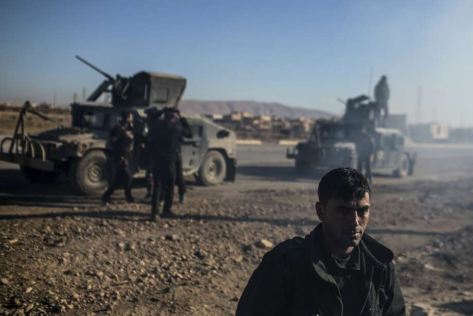 An Iraqi soldier stands near the main road from Erbil to Mosul, where the Islamic State has launched fierce counterattacks against government forces. Photo: Manu Brabo, Associated Press