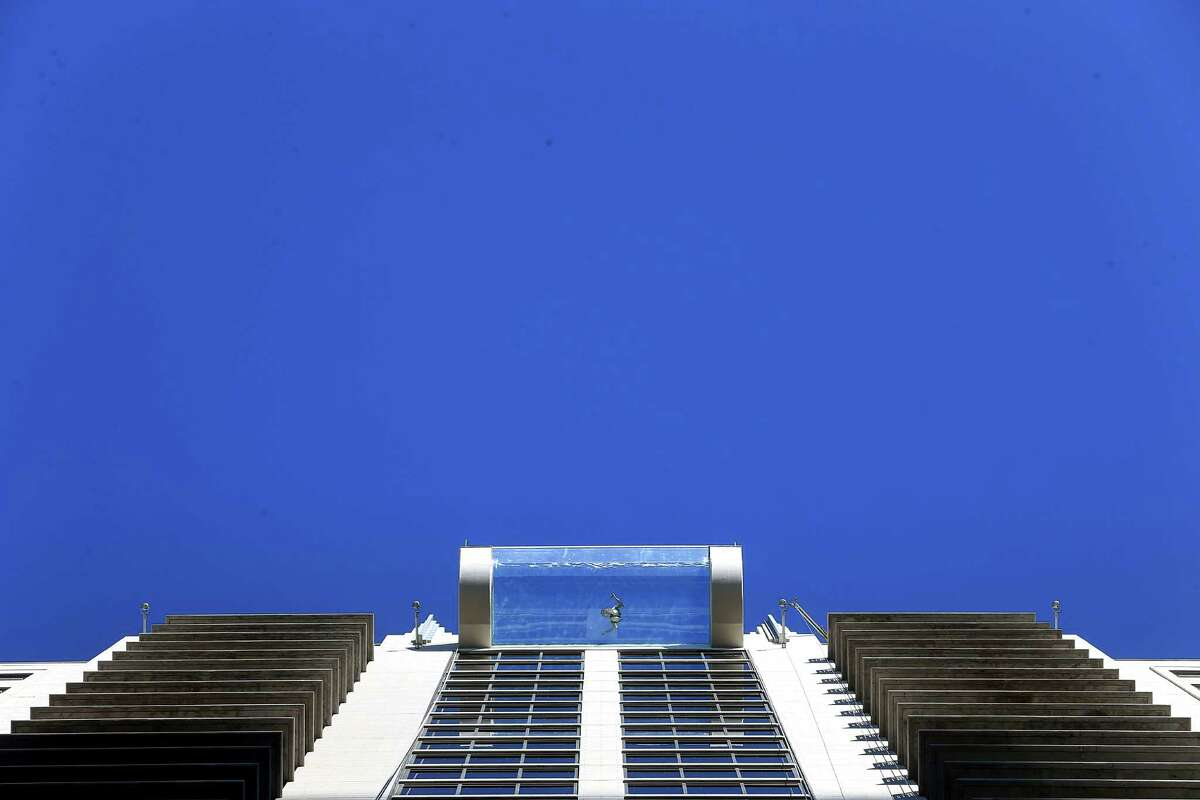 A person swims in the rooftop pool that protrudes from Market Square Tower. (For even more photos, scroll through the gallery.)