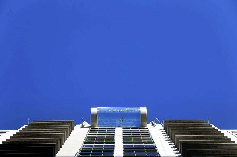 A person swims in the rooftop pool that protrudes from Market Square Tower. (For even more photos, scroll through the gallery.) Photo: Jon Shapley, Houston Chronicle / © 2015  Houston Chronicle