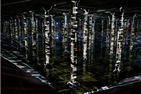 """A view of """"Rain: Magdalena Ferné¡ndez at the Houston Cistern"""" a video and sound art installation by Venezuelan artist Magdalena Ferné¡ndez is shown at the Buffalo Bayou Cistern,105 Sabine,  Wednesday, Dec. 7, 2016, in Houston. """"Rain"""" will be open to the public Wednesdays-Fridays, 3:30-7 p.m. and Saturdays-Sundays, 10 a.m.-7 p.m., Dec. 10-June 4. Admission will be $8-$10, free on Thursdays. Timed admission tickets are on sale now at buffalobayou.org. ( Melissa Phillip / Houston Chronicle )"""