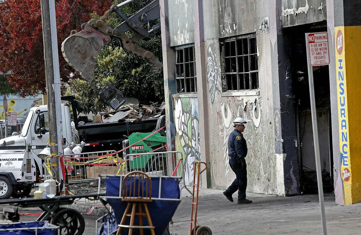 Debris continues to be removed from the site of the ghost ship warehouse fire in Oakland, California, on Wednesday December 7, 2016,