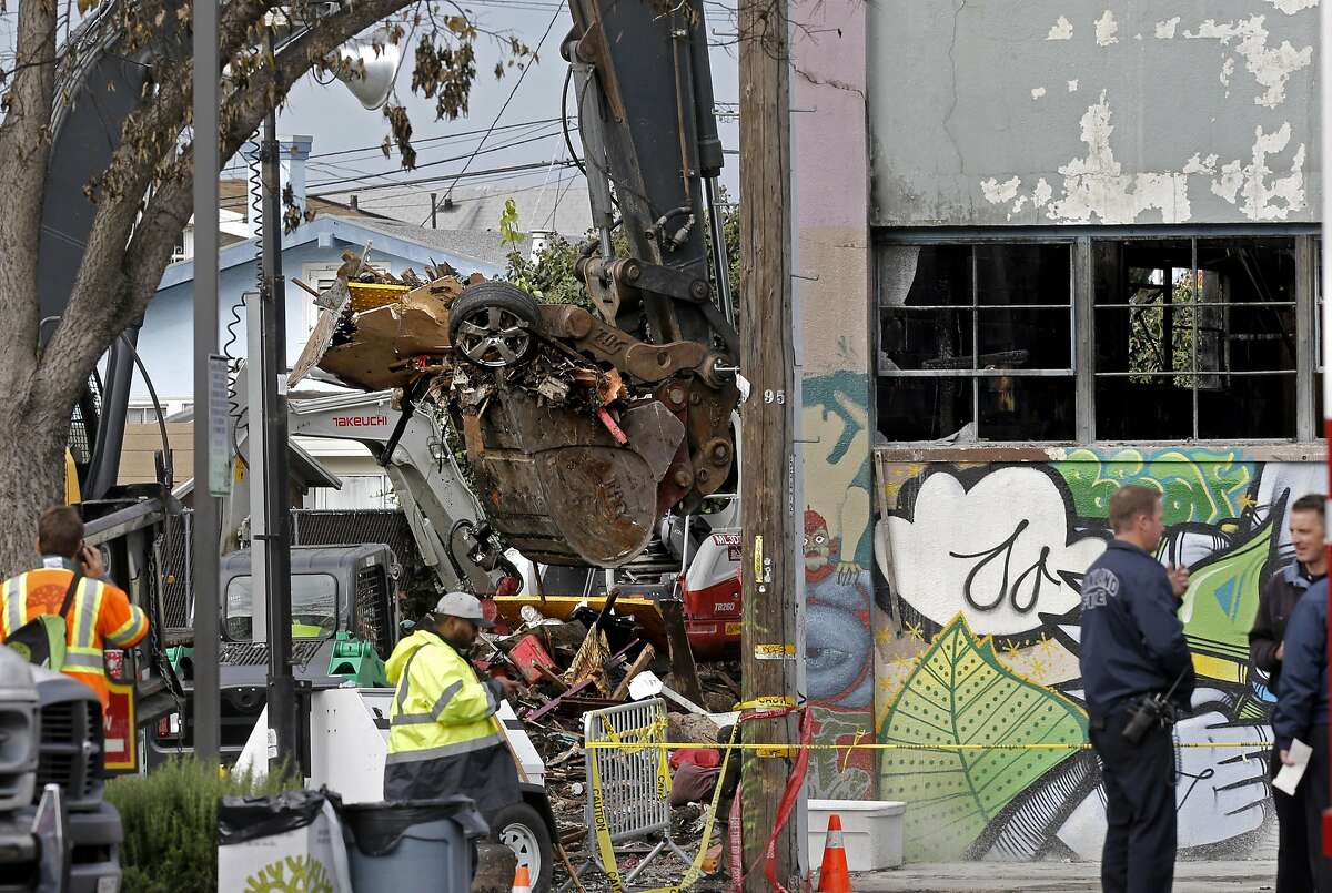 Debris continues to be taken from the site of the ghost ship warehouse fire in Oakland, California, on Wednesday December 7, 2016,