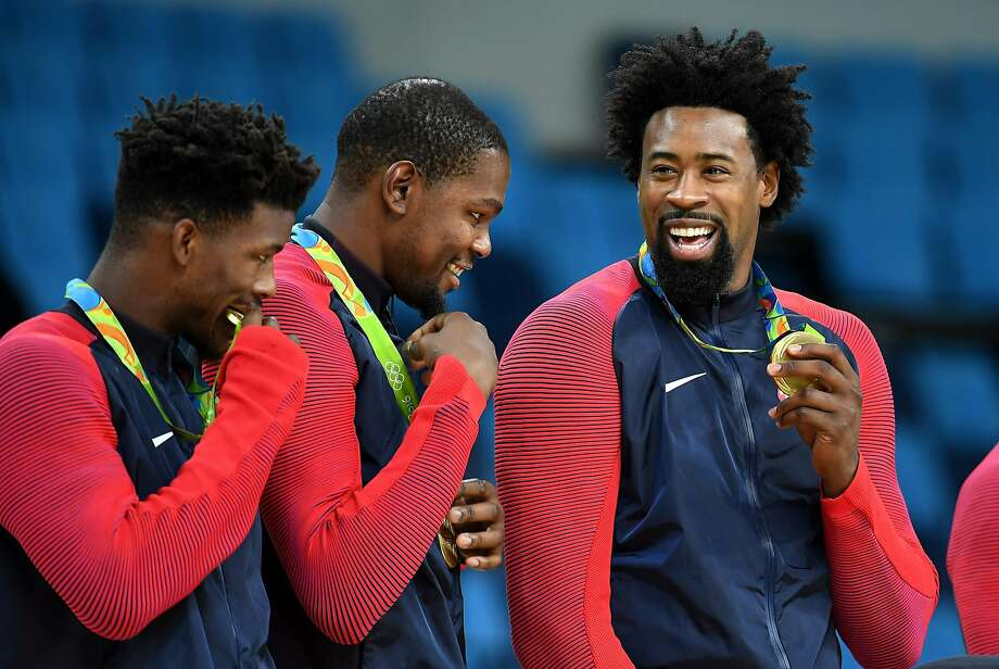 U.S. men's basketball team members, from left, Jimmy Butler, Kevin Durant and DeAndre Jordan hold their gold medals on Sunday, Aug. 21, 2016 at the Rio 2016 Olympics in Brazil. (Wally Skalij/Los Angeles Times) Photo: Wally Skalij, TNS