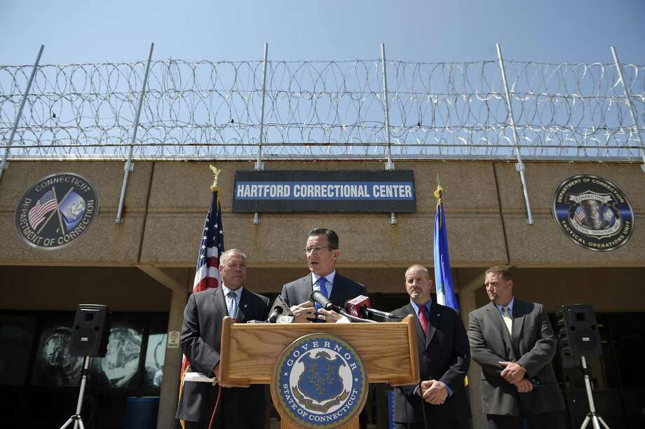 In recent years, Gov. Dannel Malloy successfully pushed for reforms including reduced penalties for drug possession, under Second Chance Society initiatives that along with reductions in crime, have led to the closure of prisons and housing units within existing correctional institutions. Photo: John Woike / Hartford Courant / Connecticut Post contributed