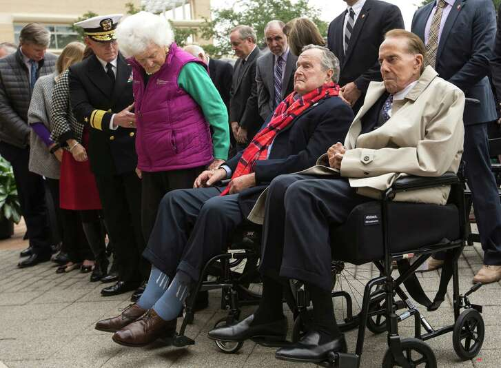 Former First Lady Barbara Bush, left, stands next to her husband, former President George H.W. Bush and Sen. Bob Dole, R-Kansas, during the playing of Taps at the 75th anniversary ceremony of the attack on Pearl Harbor at the George Bush Presidential Library on Wednesday, Dec. 7, 2016, in College Station.