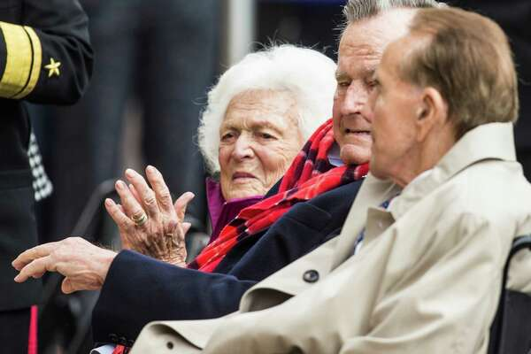 Former First Lady Barbara Bush, former President George H.W. Bush and Sen. Bob Dole, R-Kansas, sit together during the 75th anniversary ceremony of the attack on Pearl Harbor at the George Bush Presidential Library on Wednesday, Dec. 7, 2016, in College Station.