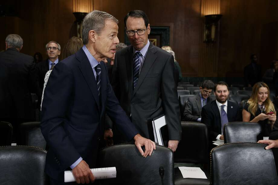 AT&T CEO Randall Stephenson (right) stands with Time Warner CEO Jeffrey Bewkes on Capitol Hill. Photo: Evan Vucci, Associated Press