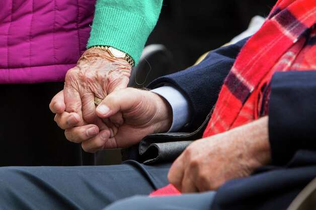Former First Lady Barbara Bush holds hands with former President George H.W. Bush during the playing of taps during the 75th anniversary ceremony of the attack on Pearl Harbor at the George Bush Presidential Library on Wednesday, Dec. 7, 2016, in College Station. Photo: Brett Coomer, Houston Chronicle / © 2016 Houston Chronicle