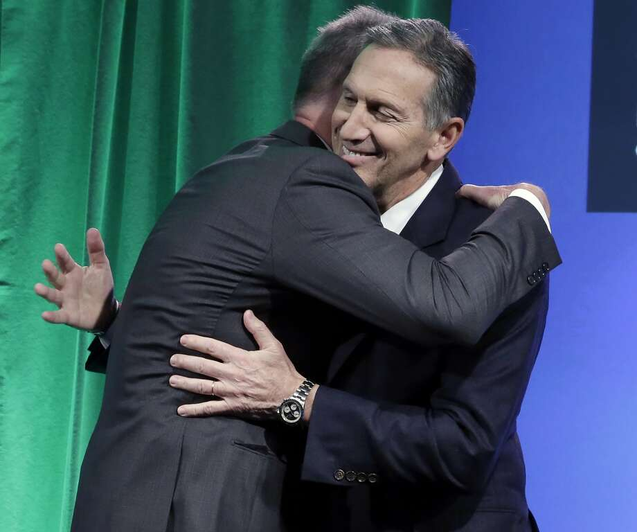 Starbucks CEO Howard Schultz (right) embraces Kevin Johnson, his eventual successor. Photo: Richard Drew, Associated Press