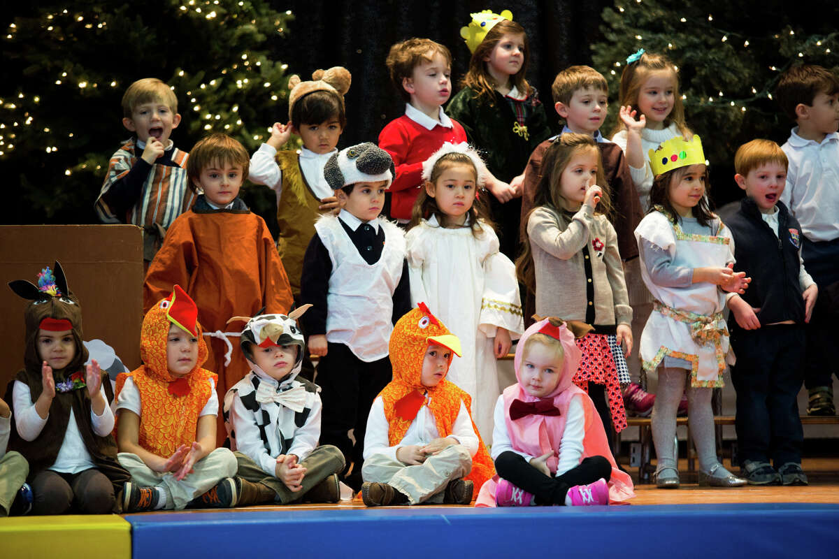 Students perform Christmas songs during the Preschool Christmas Pageant at Greenwich Catholic School Wednesday, Dec. 7, 2016 in Greenwich, Conn.