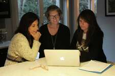 Jenn Wadehra, Rebecca Lin and Martha Borrero look through email responses for the Heritage Project.