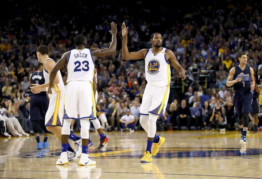 OAKLAND, CA - NOVEMBER 09:  Draymond Green #23 high-fives Kevin Durant #35 of the Golden State Warriors during their game against the Dallas Mavericks at ORACLE Arena on November 9, 2016 in Oakland, California. NOTE TO USER: User expressly acknowledges and agrees that, by downloading and or using this photograph, User is consenting to the terms and conditions of the Getty Images License Agreement.  (Photo by Ezra Shaw/Getty Images) Photo: Ezra Shaw, Getty Images