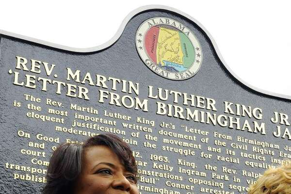 """Bernice A. King speaks in front of that jail where her father, Dr. Martin Luther King Jr. was kept in Birmingham, Ala., for the unveiling of a historic marker honoring him for writing the famous """"Letter from the Birmingham Jail."""" Donald Trump should read the letter."""