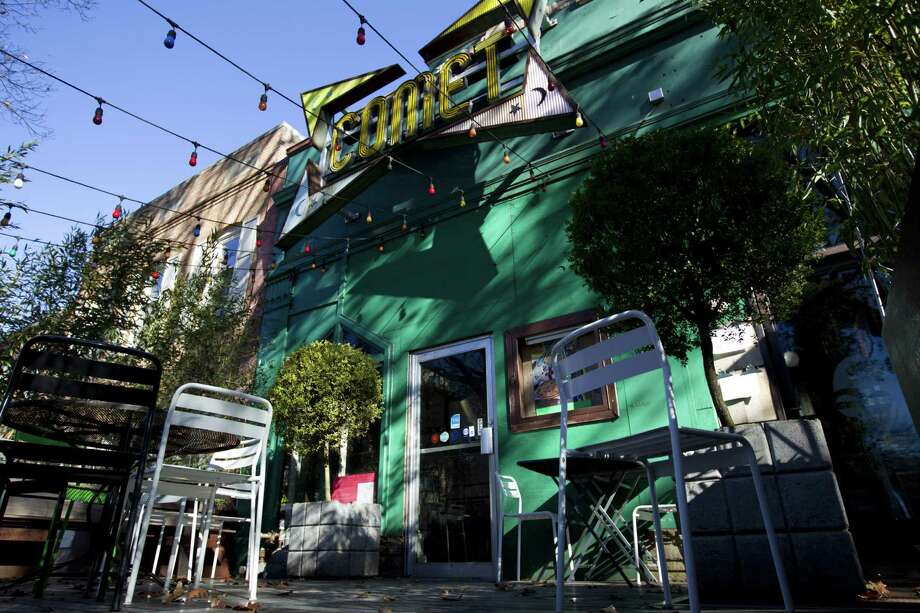 "The front door of Comet Ping Pong pizza shop, in Washington. A fake news story prompted a man to fire a rifle inside the popular Washington, D.C., pizza place as he attempted to ""self-investigate"" a conspiracy theory that Hillary Clinton was running a child sex ring from there, police said. Photo: Jose Luis Magana /Associated Press / FR159526 AP"