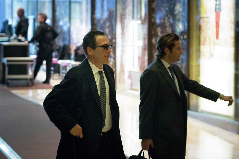 U.S. Treasury Secretary-nominee Steven Mnuchin (L) and Eli Miller, chief operating officer of the Donald Trump's presidential campaign arrive at Trump Tower on Monday. Mnuchin worked for Goldman Sachs for 17 years. So much for draining the swamp. Photo: Kevin Hagen /Getty Images / 2016 Getty Images