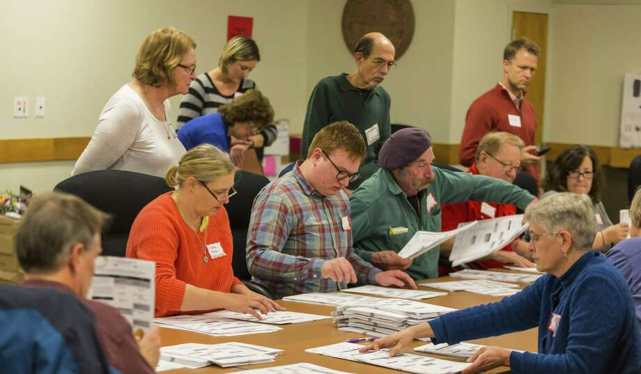 Designated observers watch as tabulators work on recounting presidential ballots in Dane County in Madison, Wisconsin. A reader criticizes an attempt by President-elect Donald Trump and his supporters to block the recount request by Green Party candidate Jill Stein. Photo: Andy Manis /Getty Images / 2016 Getty Images