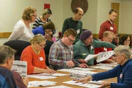 Designated observers watch as tabulators work on recounting presidential ballots in Dane County in Madison, Wisconsin. A reader criticizes an attempt by President-elect Donald Trump and his supporters to block the recount request by Green Party candidate Jill Stein.